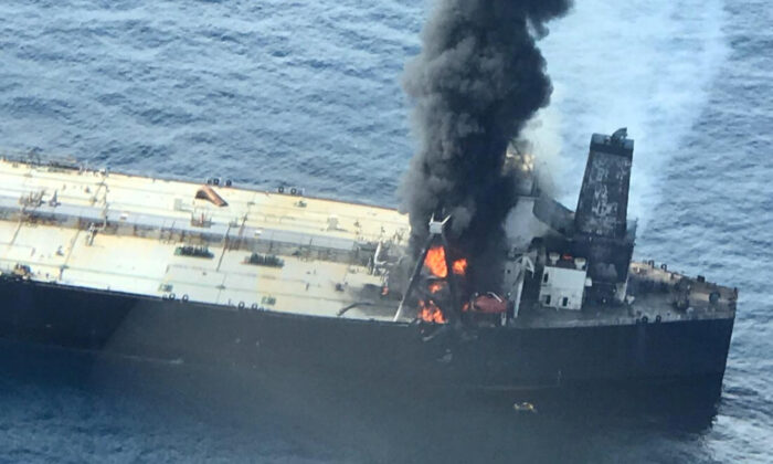 The New Diamond, a very large crude carrier, chartered by Indian Oil Corp, that was carrying the equivalent of about 2 million barrels of oil, is seen after a fire broke out off east coast of Sri Lanka, on Sept. 3, 2020. (Courtesy Sri Lankan Airforce media/Handout via Reuters)