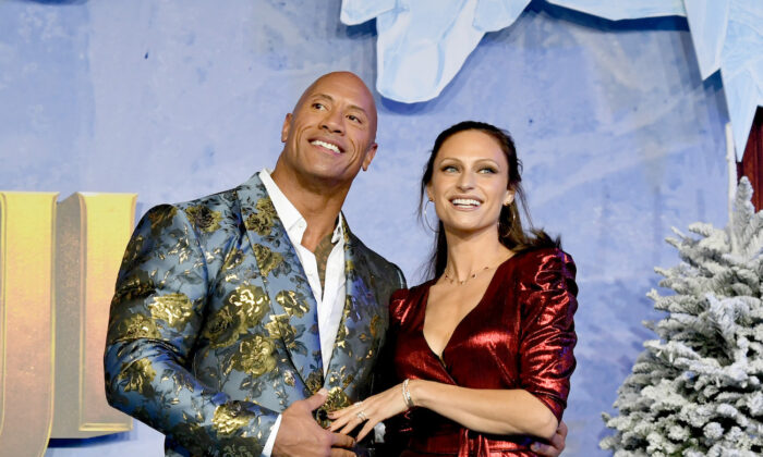 """Dwayne Johnson (L) and Lauren Hashian arrive at the premiere of Sony Pictures' """"Jumanji: The Red Carpet"""" in Hollywood, California, on Dec. 9, 2019. (Kevin Winter/Getty Images)"""