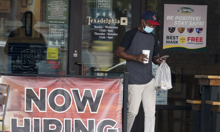 A customer walks past a now hiring sign at an eatery in Richardson, Texas, on Sept. 2, 2020. (LM Otero/AP Photo)