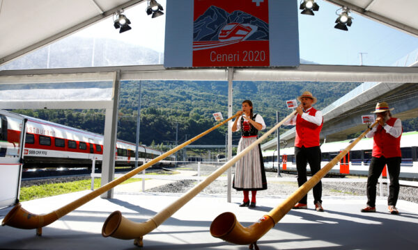Alphorn blowers perform during the opening ceremony of the newly built Ceneri Base Tunnel