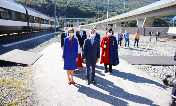 Swiss President Simonetta Sommaruga and Swiss Foreign Minister Ignazio Cassis arrive before the opening ceremony