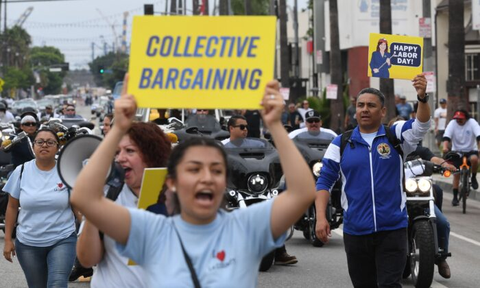 Union members and their families march through the streets during the annual Labor Day parade and rally in Long Beach, Calif., on Sept. 3, 2018. (Mark Ralston/AFP via Getty Images)