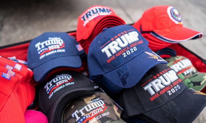 Hats to sell to supporters of US President Donald Trump are pictured outside Knapp Arena where he will later hold a campaign rally in Des Moines, Iowa on January 30, 2020. (Photo by Kerem Yucel / AFP) (Photo by KEREM YUCEL/AFP via Getty Images)