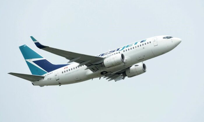 A WestJet plane takes off from Vancouver International Airport, on May 13, 2019.  (The Canadian Press/Jonathan Hayward)