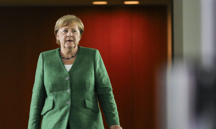 German Chancellor Angela Merkel arrives at a press conference following a virtual meeting with governors of Germany's 16 states at the Chancellery during the coronavirus pandemic in Berlin, Germany on Aug. 27, 2020. (Omer Messinger-Pool/Getty Images)