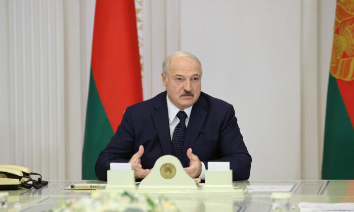 Belarusian President Alexander Lukashenko chairs a meeting on industrial development, in Minsk, Belarus Aug. 27, 2020. (Sergei Sheleg/BelTA/Handout via Reuters)