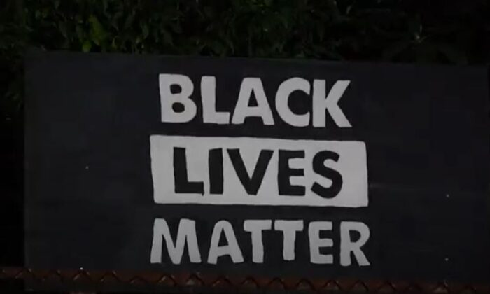 """In this still image from video, a """"Black Lives Matter"""" sign is seen in Portland, Ore., on Sept. 3, 2020. (Roman Balmakov/The Epoch Times)"""