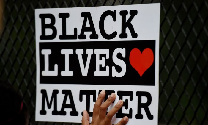 A Black Lives Matter sign is held in Washington in a June 4, 2020, file photograph. (Olivier Douliery/AFP via Getty Images)