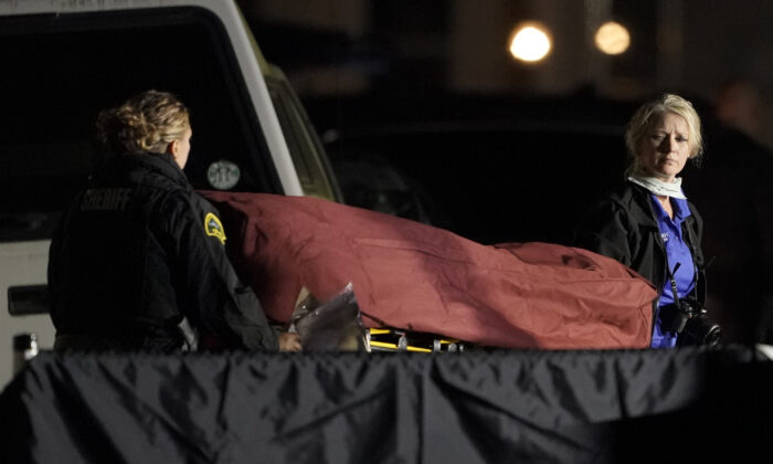 The body of Michael Reinoehl is taken away on a stretcher in in Lacey, Wash., early Sept. 4, 2020. (Ted S. Warren/AP Photo)