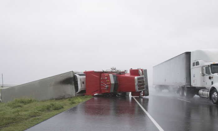 A big rig lies on it's side on Hwy 59 near Edna, Texas, south of Houston, in the aftermath of Hurricane Harvey on Aug. 26, 2017. (Daniel Kramer/AFP via Getty Images)