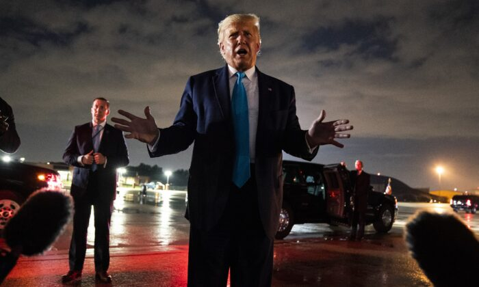 President Donald Trump talks with reporters at Andrews Air Force Base after attending a campaign rally in Latrobe, Pa., at Andrews Air Force Base, Md., on Sept. 3, 2020. (Evan Vucci/AP Photo)