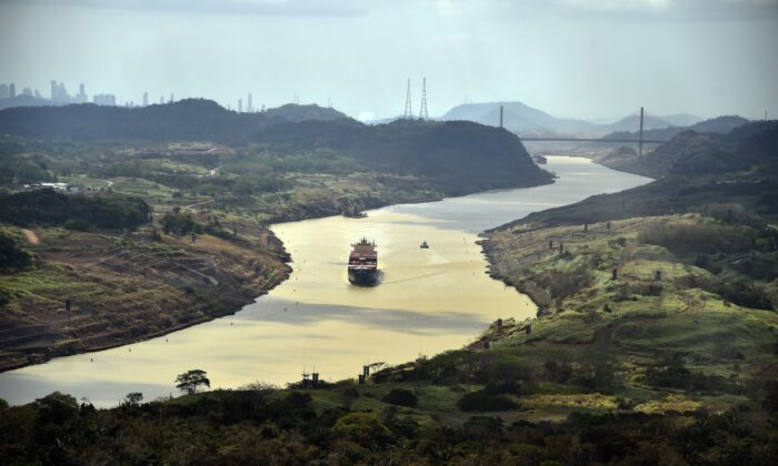 A merchant ship sails along the Panama Canal on March 23, 2015. (Rodrigo Arangua/AFP via Getty Images)