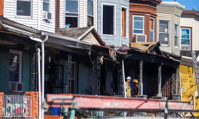 Firefighters investigate the scene after a row home fire in Philadelphia, on Sept. 5, 2020.  (Tyger Williams/The Philadelphia Inquirer via AP)