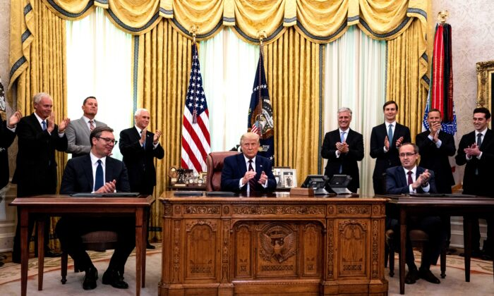 President Donald Trump, center, participates in a signing ceremony and meeting with the President of Serbia Aleksandar Vucic, left, and the Prime Minister of Kosovo Avdullah Hoti, right, in the Oval Office of the White House on Sept. 4, 2020. (Anna Moneymaker-Pool/Getty Images)