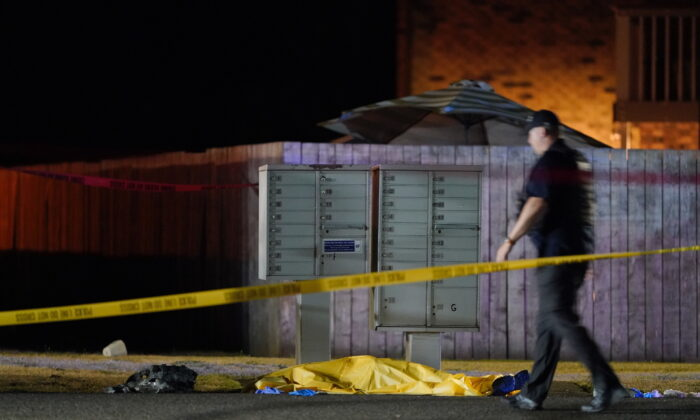 The scene where Michael Forest Reinoehl was shot by law enforcement officers who tried apprehending him is seen in Lacey, Wash., on Sept. 3, 2020. (Ted Warren/AP Photo)