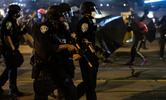 Police disperse a crowd in Rochester, N.Y., on Sept. 4, 2020. (Maranie R. Staab/AFP via Getty Images)