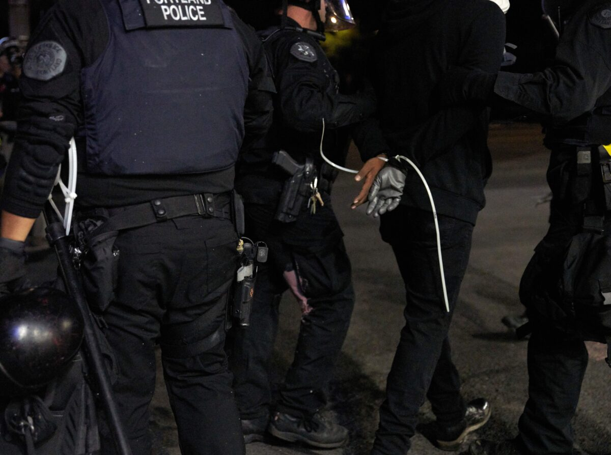 Oregon State Police arrest a person during rioting Portland, Ore., on Sept. 4, 2020. (Nathan Howard/Getty Images)