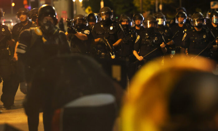 Police officers attempt to clear the streets after a march for Daniel Prude in Rochester, N.Y., Sept. 4, 2020. (Michael M. Santiago/Getty Images)