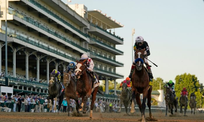 Jockey John Velazquez riding Authentic (R) crosses the finish line to win the 146th running of the Kentucky Derby at Churchill Downs, in Louisville, Ky., on Sept. 5, 2020. (Jeff Roberson/AP Photo)