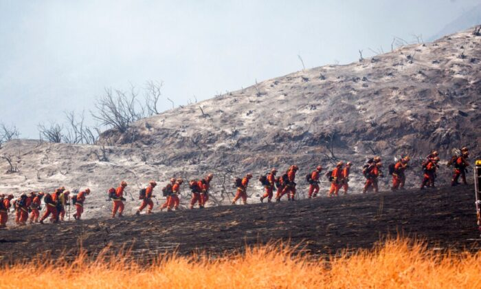 An air tanker drops retardant as a wildfire burns at a hillside in Yucaipa, Calif., on Sept. 5, 2020. (Ringo H.W. Chiu/AP Photo)