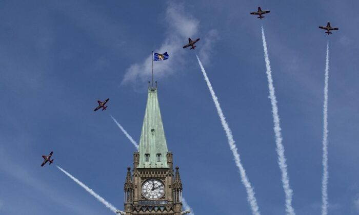 Royal Canadian Air Force Snowbirds fly past the Peace Tower during the Canada Day noon show on Parliament Hill in Ottawa on July 1, 2019.  (The Canadian Press/Justin Tang)
