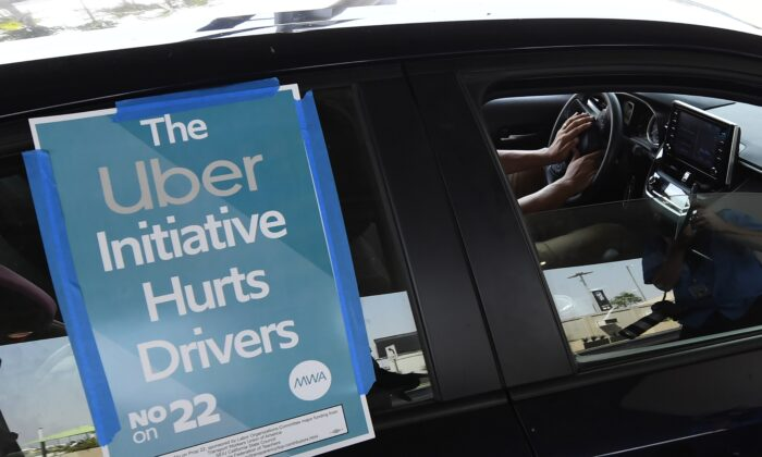 A ride share driver participates in a protest by drivers and their supporters at Los Angeles International Airport in Los Angeles, Calif. on Aug. 20, 2020. (Robyn Beck/AFP via Getty Images)
