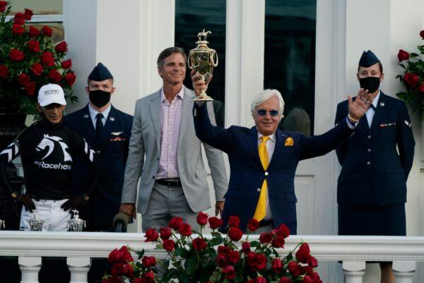 Bob Baffert holds the trophy