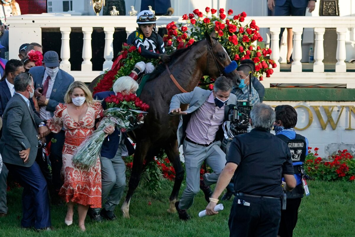 Trainer Bob Baffert attempts to get out of the way