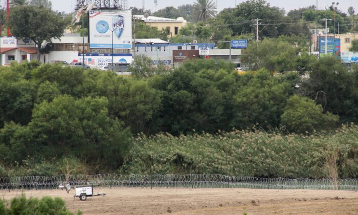 Military fencing can be seen along the Rio Grande in Laredo, Texas. The opposite side of the river is Nuevo Laredo, Mexico, on Nov. 18, 2018. (Thomas Watkins/AFP via Getty Images)