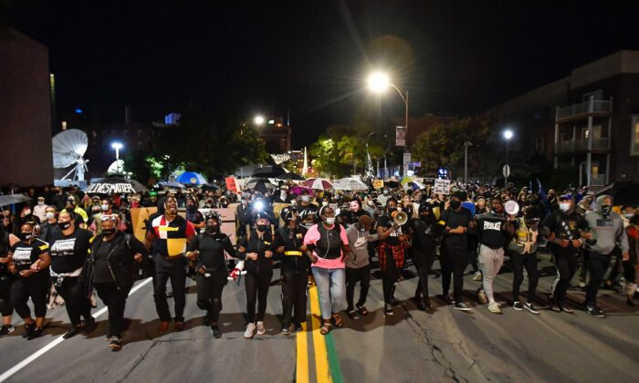 Demonstrators march through the streets protesting the death of Daniel Prude in Rochester, N.Y., on Sept. 4, 2020. (Adrian Kraus/AP Photo)