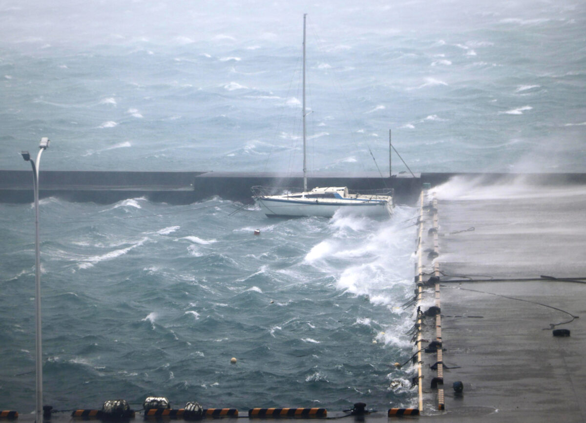 High waves pound a fishing port