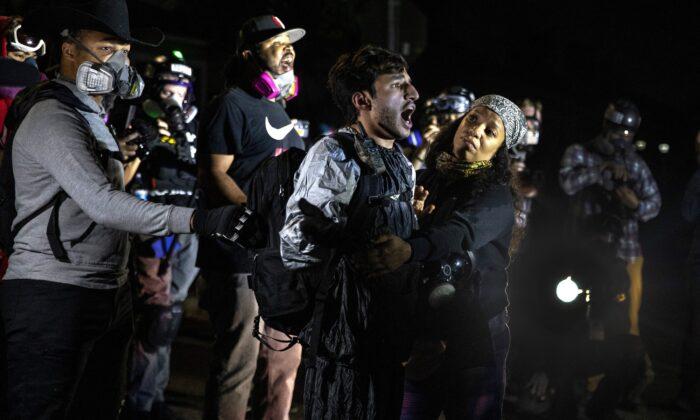 A man screams at police during a Black Lives Matter march that turned into a riot, in Portland, Ore., Sept. 5, 2020. (Paula Bronstein/AP Photo)