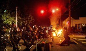 Staffer for Top Oregon Democrat Arrested During Riot in Portland