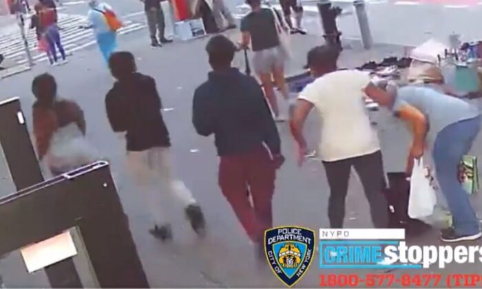 Police in New York City are searching for a group of teenagers or young adults who punched a 74-year-old woman in the face and took her purse in Manhattan. (NYPD)