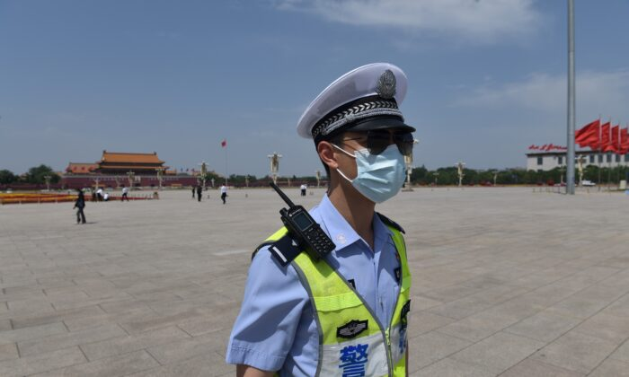 A policeman patrols in Tiananmen Square ahead of the closing session of the National People's Congress at the adjacent Great Hall of the People in Beijing on May 28, 2020.  (Nicolas Asfouri/AFP via Getty Images)