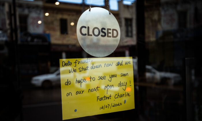 Shops on Sydney Road in Brunswick display signs informing customers of their closure in Melbourne, Australia on Aug. 5, 2020. (Darrian Traynor/Getty Images)