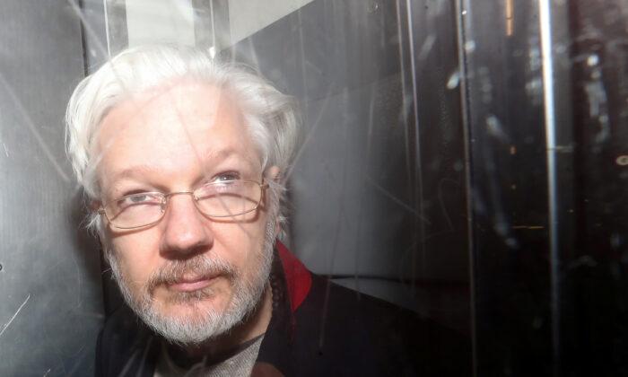WikiLeaks' founder Julian Assange leaves Westminster Magistrates Court in London, Britain, on Jan. 13, 2020. (Simon Dawson/Reuters)