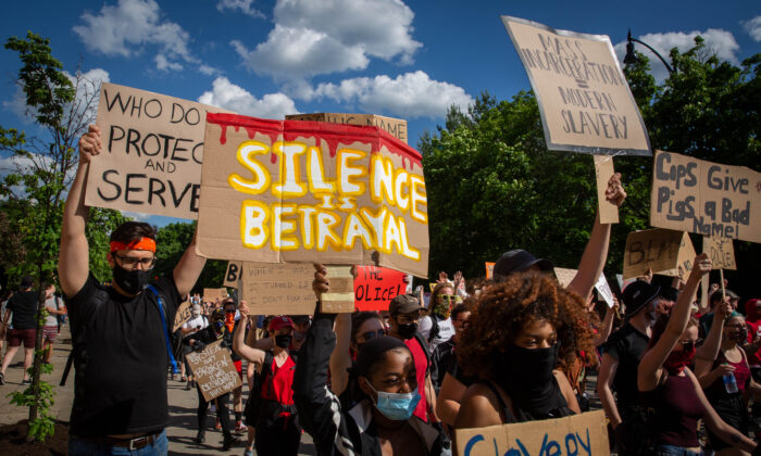 Protesters hold up placards as they march during a demonstration in Pittsburgh, Pa., on June 6, 2020. (Maranie R. Staab/AFP via Getty Images)