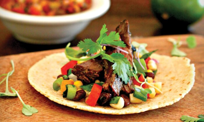 Grilled skirt steak and a fresh black bean and corn salsa in a warmed flour tortilla. (Lynda Balslev for TasteFood)