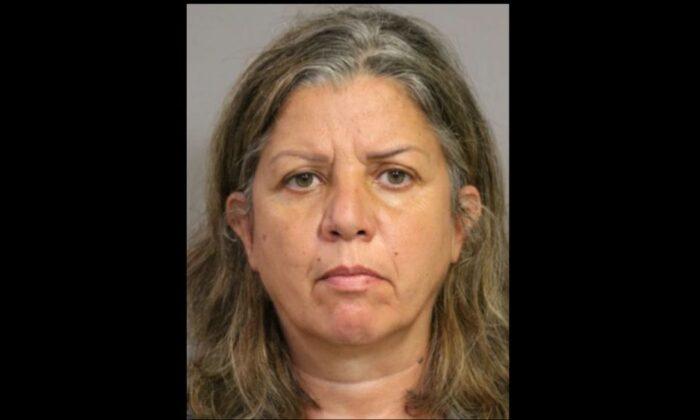 Rima Abikaram in a booking photo released by Costa Mesa police. (Costa Mesa Police)