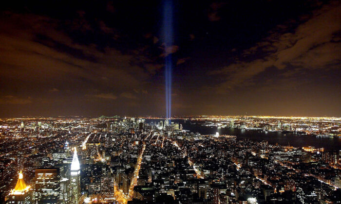 """The """"Tribute in Light"""" memorial to the World Trade Center is seen from the Empire State Building in New York City on April 3, 2002. (Mario Tama/Getty Images)"""