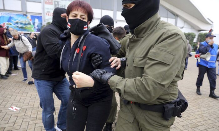 A woman is detained during a rally in support of Maria Kolesnikova, a member of the Coordination Council created by the opposition to facilitate talks with President Alexander Lukashenko on a transition of power, in Minsk, Belarus, on Sept. 8, 2020. (AP Photo)