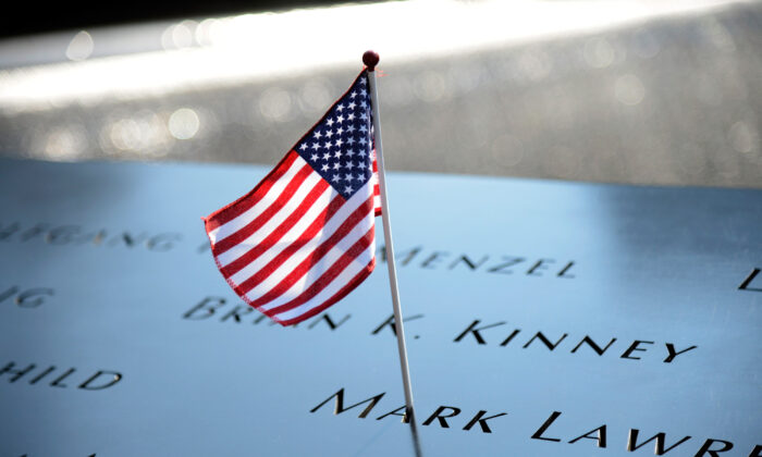 In this file photo, a flag adorns the 9/11 Memorial on the 12th anniversary of the terrorist attacks on lower Manhattan at the World Trade Center site in New York on Sept. 11, 2013. (Kevin Mazur/Getty Images)