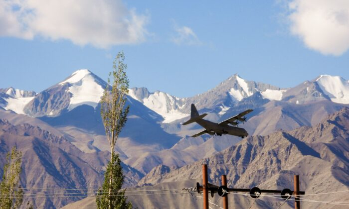 An Indian Air Force Hercules military transport plane prepares to land at an airbase in Leh, the joint capital of the union territory of Ladakh bordering China, on Sept. 8, 2020. (Mohd Arhaan Archer/AFP via Getty Images)
