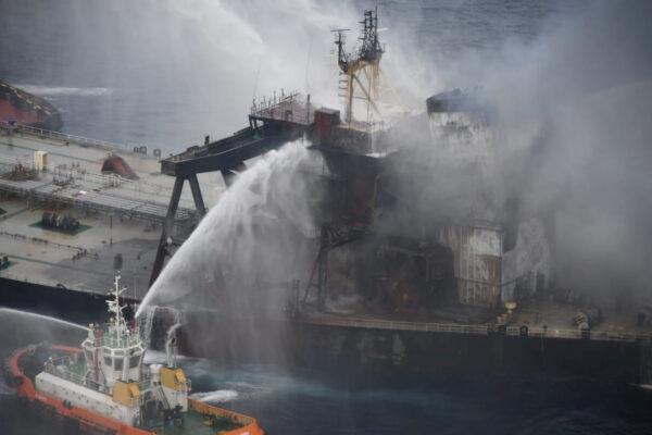 A Sri Lankan Navy boat sprays water