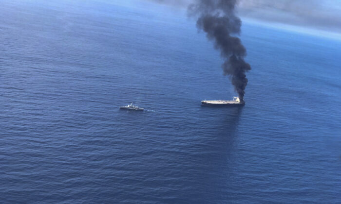 Smoke rising after a fire broke out on a Panama-registered oil tanker about 38 nautical miles (70 kilometers) east of Sri Lanka, on Sept.3, 2020. (Sri Lankan Air Force via AP)