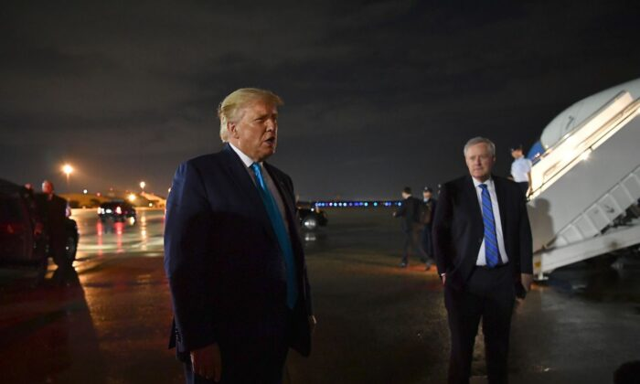 President Donald Trump, next to White House chief of staff Mark Meadows, speaks to reporters upon arrival at Andrews Air Force Base in Maryland on Sept. 3, 2020. (Mandel Ngan/AFP via Getty Images)