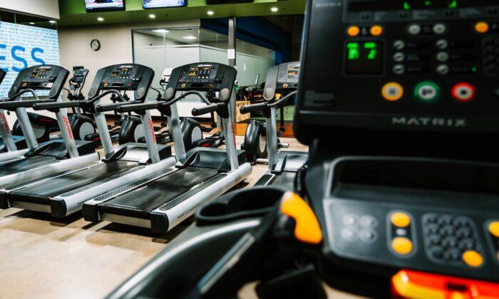 Stock photo of treadmills in an empty gym. (Ryan De Hamer/Unsplash)