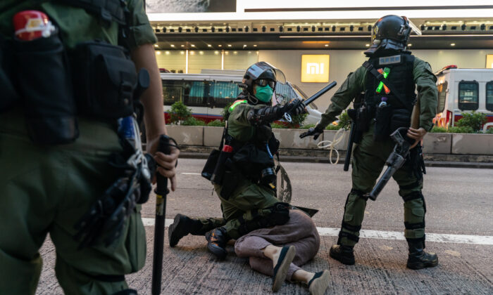 Riot police arrest a man during a pro-democracy protest in Hong Kong on Sept. 6, 2020. (Anthony Kwan/Getty Images)