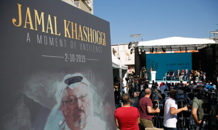A picture of slain Saudi journalist Jamal Kashoggi, is displayed during a ceremony near the Saudi Arabia consulate in Istanbul on Oct. 2, 2019.(Lefteris Pitarakis/AP)